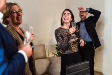 Group Of People With Champagne Glasses During Christmas Party At Home Having Fun