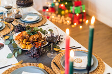 From Above Of Yummy Chicken With Baked Vegetables Near Glasses Of Red Wine During Festive Event
