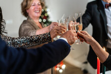 From Above Of Unrecognizable Group Of People Clinking Glasses With Champagne During Christmas Party At Home