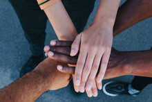From Above Cropped Unrecognizable African American People Putting Hands Together Standing On The Street