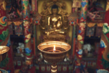 High Angle Of Burning Candle In Candlestick Lit For Prayer In Holy Place In Buddhist Temple In China