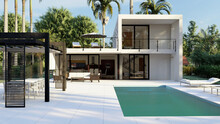 Exterior Of Contemporary Villa House With Swimming Pool And Comfortable Recreation Area Surrounded By Green Tropical Trees