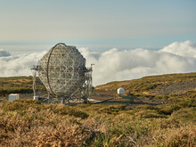 Amazing View Of Modern Telescopes On Dark Mountaintop Against Cloudy Sky At Astronomical Observatory On Island Of La Palma In Spain