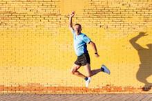 Senior Retired Man Athlete Jumping On Yellow Background