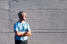 Portrait Of Senior Retired Man Athlete On Street