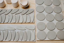 From Above Of Pieces Of Clay Of Different Sizes And Shapes Prepared On Workbench For Creating Pottery In Studio