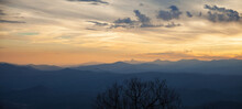 Sunset In Winter In The Applachain Mountains, Vivid Sky With Orange Hues And Layers Of Smoky Blue Mountains