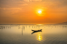 Fishing Boat In The Big Lagoon At Sunset Sky. This Is The Main Means Of Transportation To Catch Fish Of Fishermen In Central Vietnam