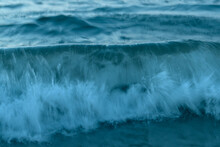 Blue Wave Breaking On The Shore Captured In Slow Motion