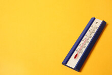 Weather Thermometer On Yellow Background. Space For Text