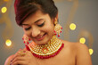 Beautiful Indian young women portrait with Indian traditional jewelry studio shot.