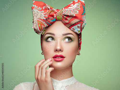 Leinwand Poster Portrait of beautiful young woman with bow