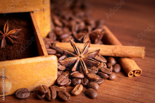 Fototapeta Vintage classic antique italy german hand manual ground coffee grinder powder of organic roasted espresso bean cinnamon star anise aroma in retro old wooden rustic homemade cafe shop barista style obraz