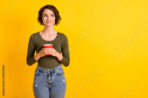 Vászonkép Photo of charming lovely girl hold coffee cup look empty space isolated over vib