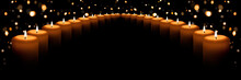 The Flame Of Many White Candles On A Black Background With A Golden Bokeh. Banner With Space For Text.