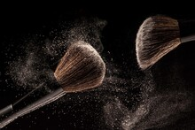 Makeup Brushes, Powder Particles Dynamically In The Air. Spray Cosmetics. Frozen Dust, Space Simulation.