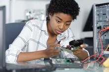 Female Computer Technician Fixes A Computer
