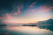 Sanur Bali. Beach Photo On The Island Of The Gods. Beautiful Sunrise By The Sea With Temple And Bood. View Of The Sea In The Morning, Purple Sky