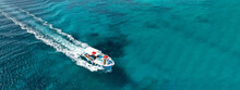 Aerial Drone Ultra Wide Photo Of Traditional Fishing Boat In Ionian Bay With Emerald Sea, Greece