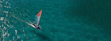 Aerial Drone Ultra Wide Photo Of Professional Wind Surfer Practice In Deep Blue Open Ocean Sea