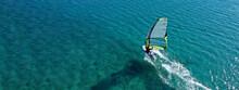 Aerial Drone Ultra Wide Photo Of Professional Wind Surfer Practice In Deep Blue Open Ocean Sea