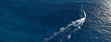 Aerial Drone Ultra Wide Photo Of Sail Boat Cruising In The Deep Blue Aegean Sea, Greece