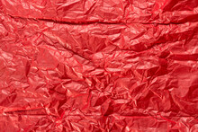 Bright Red Wrapping Paper Crumpled Paper Texture. Creased Sheet Background. Textured Effect.