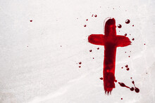 Christian Cross Painted With Red Blood On Stone Background. Copy Space. Good Friday. Passion, Crucifixion Of Jesus Christ. Christian Easter Holiday. Crucifix, Gospel, Salvation Concept