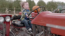 Cute Little Boy Pretending To Drive A Old Tractor
