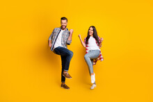 Full Length Photo Portrait Of Excited Wife And Husband Celebrating Victory Isolated On Vivid Yellow Colored Background