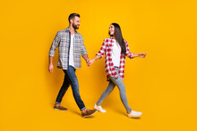 Photo Portrait Full Body View Of Man And Woman Holding Hands Walking Isolated On Vivid Yellow Colored Background