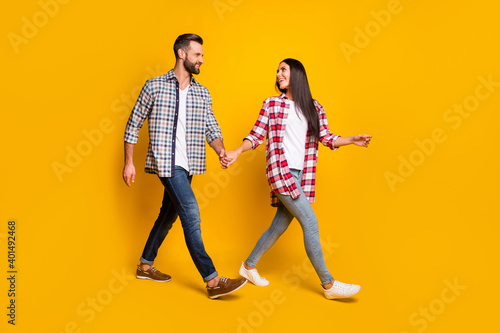 Photo portrait full body view of man and woman holding hands walking isolated on Wallpaper Mural