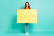 canvas print picture - Full size photo of young beautiful happy cheerful smiling girl hold big banner advertisement isolated on teal color background