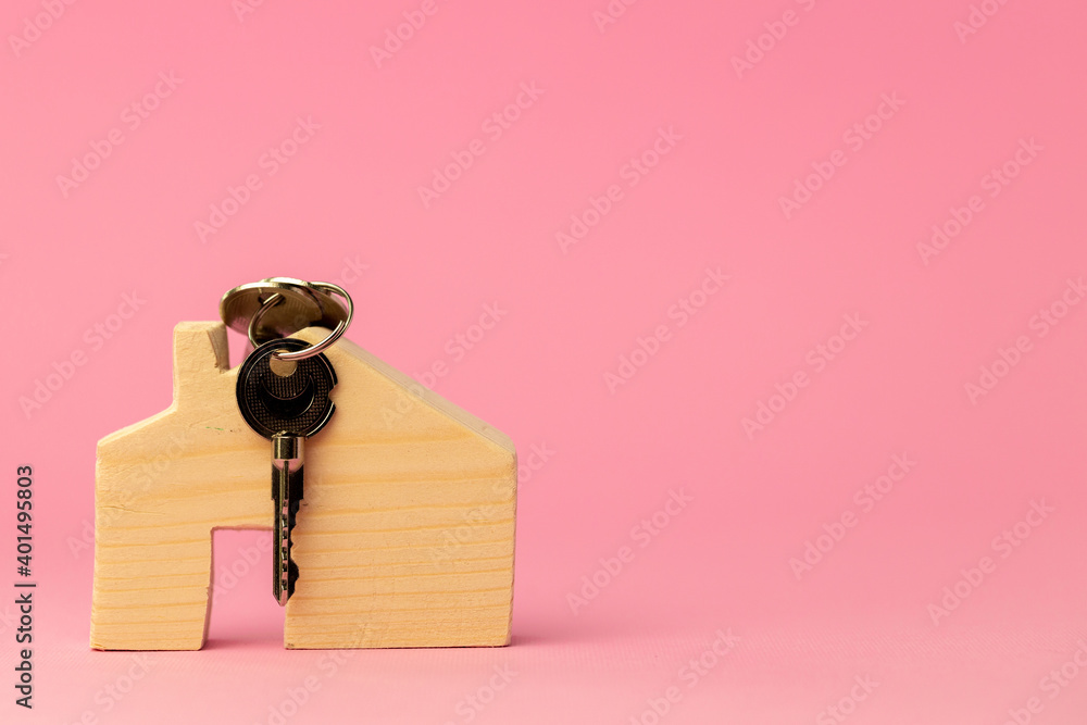 Fototapeta Wooden toy house and house keys close up