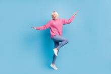 Photo Portrait Full Body View Of Happy Old Lady Dancing Standing On One Leg Isolated On Pastel Blue Colored Background