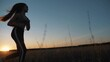 Silhouette of a running girl, healthy lifestyle. Jogging sportswoman at sunset. Silhouette of running athlete man. Girl training at sunset. Outdoor sports training. sports running. beautiful girl.