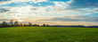 Landscape panorama. Sky with clouds. Green meadow. Gorgeous rural scene. Large open space.