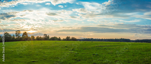 Obraz Landscape panorama. Sky with clouds. Green meadow. Gorgeous rural scene. Large open space. - fototapety do salonu