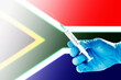 canvas print picture - South Africa Flag Blurred Background Covid-19, Corona, Selective focused on Syringe Injection
