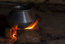 Villagers Cooking Rise In An Aluminum Utensil With Wood Fire.