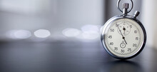 Clock On A Blurred Background. 5 Minutes Before The Midnight
