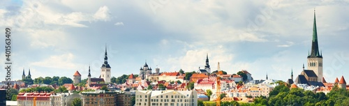 Obraz Panoramic aerial view of the Tallinn old town, Estonia. Dramatic sky, summer cityscape. Cathedrals, fortress towers and historical architecture close-up. Tourism, landmarks, sightseeing, travel guide - fototapety do salonu