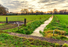December Sunset Over A Polder Landscape With A Ditch In Lunteren NL
