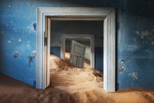 Abandoned Building And The Door Being Taken Over By Encroaching Sand, Kolmanskop Ghost Town, Namib Desert