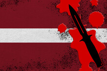 Latvia Flag And Black Tactical Knife In Red Blood. Concept For Terror Attack Or Military Operations With Lethal Outcome