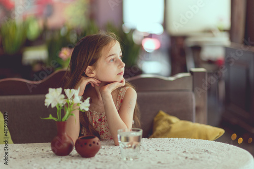 Fotografie, Obraz Adorable little girl drinking water from a glass