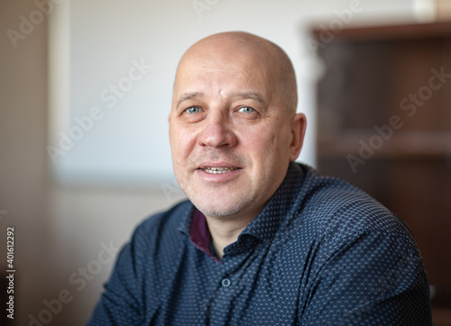 Fotografiet Portrait of a young brutal man with a short haircut