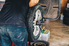 Car Tires Chang In The Auto Repair Service Store Center