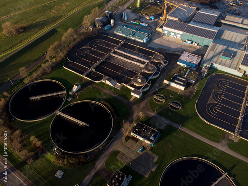 Photo Aerial view of circular rectangle basins of water treatment facility in The Neth