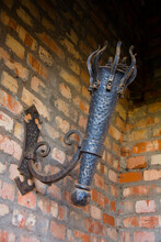 Antique Metal Torch Holder On The Wall.
